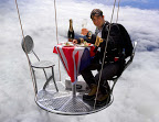 Bear Grylls dining in hot air balloon
