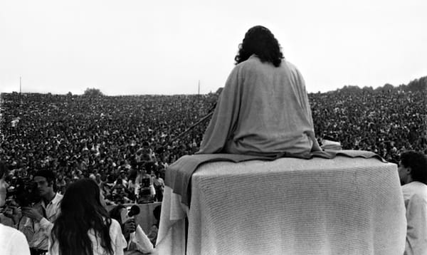 Swami Satchidananda at Woodstock. Source: SwamiSatchidananda.com